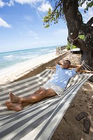 Mature man lying on hammock (thumbnail)