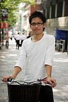 Portrait of a young man with bicycle