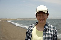 Portrait of a young man on beach (thumbnail)