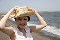 Portrait of a young woman on beach (thumbnail)