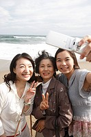 Daughter 14_15 with mother and grandmother photographing self