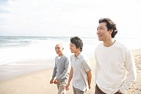Young man with father and grandfather at beach (thumbnail)