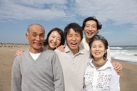 Family at beach smiling, portrait