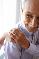 Senior man holding hands, close_up