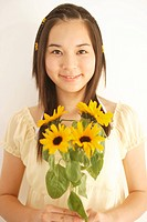 Teenage girl 14-15 with flowers, portrait (thumbnail)