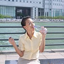 Businesswoman drinking water from a bottle
