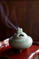 Close_up of white incense burner
