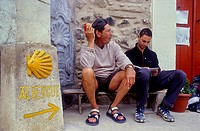 Pilgrims resting near Camino de Santiago Signposting in front of Pilgrim´s hostel in Belorado  Burgos province Spain  Camino de Santiago