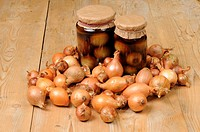 Onion Allium cepa two jars of homemade pickled onions, on kitchen table, England, september