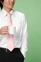 Young man holding tea cup
