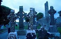 High crosses in front of the ruins of Monasterboice abbey at dusk, County Louth, Ireland, Europe