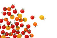 Yellow, orange and red cherry tomatoes on white background, close_up
