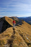 Woman hiking on trail at Fleischbank, Karwendel range, Tyrol, Austria