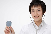 Female doctor with stethoscope, smiling, portrait