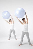 Women holding exercise ball, portrait