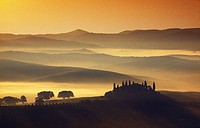 Country house on a hill in the morning mist, Val d´Orcia, Tuscany, Italy, Europe