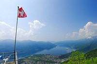 Flag of Switzerland above delta of river Maggia with Locarno and Ascona at lake Maggiore, Alpe Cardada, Locarno, Lago Maggiore, Ticino, Switzerland