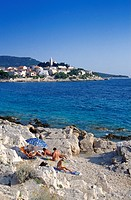 People sunbathing at the coast of Primosten, Croatian Adriatic Sea, Dalmatia, Croatia, Europe