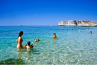 People bathing in the sea in front of the Old Town of Dubrovnik, Croatian Adriatic Sea, Dalmatia, Croatia, Europe