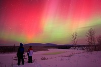 People watching Aurora Borealis or Northern Lights, Yukon.