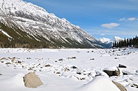 A snow covered winter scenic of Medicine Lake and the Rocky Mountains in Jasper National Park