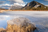 Partly frozen Vermillion Lake and Mt. Rundle, Alberta, Canada