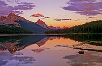 Evening alpenglow on mountain ranges surrounding Maligne Lake. Jasper National Park, Alberta, Canada