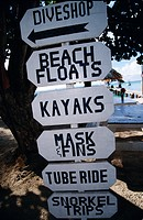 Sign showing a variety of activities for tourists Fiji.
