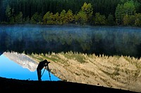 Mountain reflections in Wedge Pond, with photographer silhouette