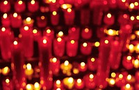 Close_up of burning candles in a church, Barcelona, Spain.
