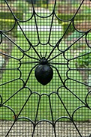 Spider web wrought iron garden gate, Norfolk, England