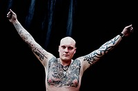 A man displaying his tattos on arms and chest during a tattoo expo in Goteborg Goteborg Sweden.