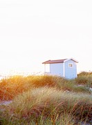 A bathing_hut on a beach.