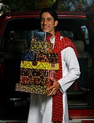 Man with gifts on Diwali