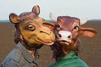 Two people wearing animal masks, close_up