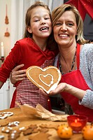 Mother and daughter baking gingerbread biscuits Sweden.