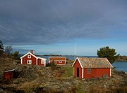 Red cottages Tjust archipelago Sweden.