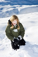 A girl playing in the snow.