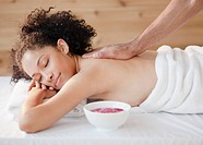 Mixed race woman receiving massage