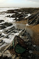 Lobster pots washed up in a storm on Aberystwyth North Beach, Wales