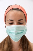 Teenage girl. Mask of prevention against swine influenza H1N1.