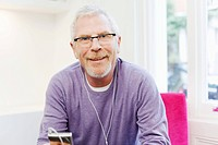 Mature man listening to mp3 player