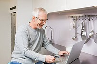 Mature man using internet banking