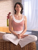 Woman sitting cross_legged doing yoga exercise