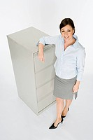 Businesswoman and filing cabinet