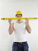 Construction worker with spirit level