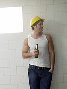 Construction worker holding a bottle of beer