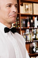 Close_up of a waiter looking displeased