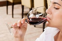 Businesswoman drinking wine