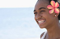 Close_up of a woman smiling on the beach